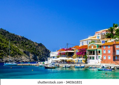 ASSOS TOWN, KEFALONIA ISLAND, GREECE - JULY 12, 2015: Bay of Assos with boats and yachts. Assos village on the Island of Kefalonia in Greece.