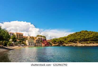 Assos village, Kefalonia island, Greece. Colorful mediterranean houses and turquoise Ionian Sea.