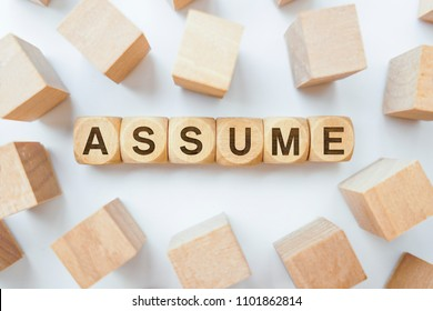 Assume word on wooden cubes