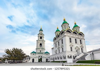 Assumption Cathedral of the Blessed Virgin Mary, snow white christian church, in cold summer weather under thick clouds or veil. Historical and architectural complex Astrakhan Kremlin, Russia.