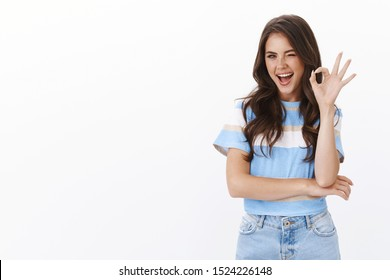 Assured ambitious lovely female entrepreneur self-assured looking confident, wink and smiling motivated show okay ok, no problem sign, give positive feedback, like idea, judging cool product