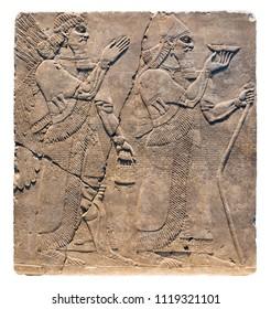 Assyrian art on the wall, King Ashurnasirpal II and genius.