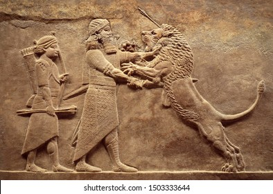 Assyrian wall relief, detail of panorama with royal lion hunt. Old carving from the Middle East history. Remains of culture of Mesopotamia ancient civilization. Amazing Babylonian and Sumerian art.