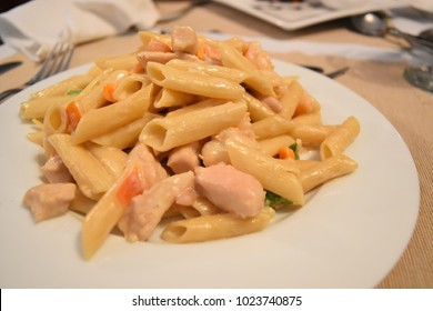 asta ala cream with chicken on a black background Penne macaroni