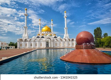 Astana, Kasakhstan, beautiful gold and white Nur Astana mosque is one of the biggest in Central Asia. The name of the mosque is written over the entrance in green letters in kazakh language.