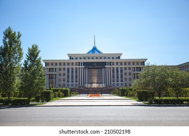 Astana, Kazakhstan - August 10, 2014: Building of the Ministry of Defence of the Republic of Kazakhstan, trees and cloud.