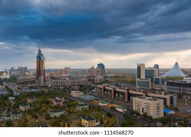 ASTANA, KAZAKHSTAN - August 25, 2015: Evening view from the top on a round square with the complex Transport Tower and the office of KazMunaiGaz, shopping center Khan Shatyr and Nur-Astana Mosque