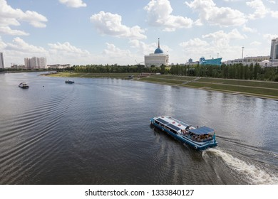Astana, Kazakhstan, August 3 2018: Skyline of downtown Astana with Yesil River and the Residence of the President Ak Orda during the summer