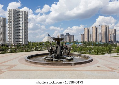 Astana, Kazakhstan, August 3 2018: Fountain in front of the National Museum and the Palace of Peace and Reconciliation in the background