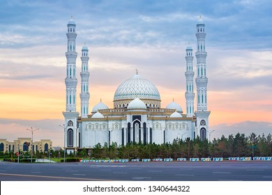 Astana, Kazakhstan, beautiful white Hazrat Sultan mosque, the largest mosque in Central Asia, in dramatical sunset light