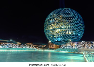"Astana, Kazakhstan - December 2017: View of the ""Nur Alem"" exhibition complex from the nearby outdoor ice rink"