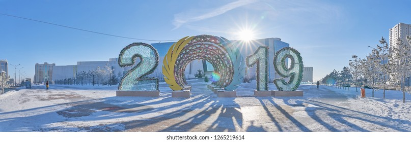 Astana, Kazakhstan - December 21, 2017: Beautiful winter landscape of Astana. Winter view of the National Museum of the Republic of Kazakhstan. 2019 digits New Year background - Image