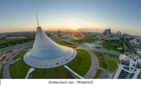 ASTANA, KAZAKHSTAN - JULY 2016: Elevated view with sunrise over the city center with Khan Shatyr and central business district transition Timelapse before sunrise time from rooftop, Kazakhstan, Astana