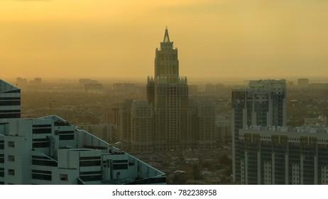 ASTANA, KAZAKHSTAN - JULY 2016: Triumph of Astana building timelapse at sunset time from the top of Baiterek tower. Astana, Kazakhstan