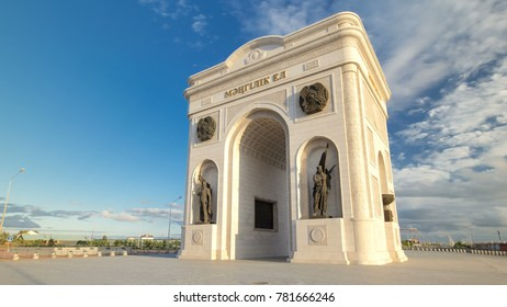 ASTANA, KAZAKHSTAN - JULY 2016: triumphal arch timelapse hyperlapse with solders statues and the central part of the city with clouds in summer day in Astana, Kazakhstan.