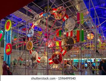 Astana, Kazakhstan - July 5, 2017: Fun fair with dynamic recreational facilities in Austria Pavilion at EXPO. Installation of kinetic energy. Words: 'Austria'