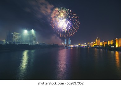 Astana, Kazakhstan - July 6, 2016: Salute in Astana on the day the capital of the Republic of Kazakhstan. The Ishim River is seen beautiful reflection. The capital celebrates and people relax.