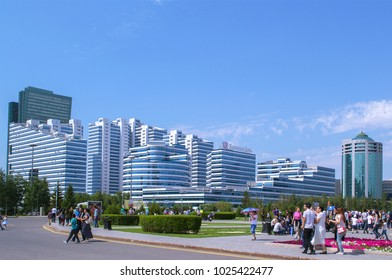 Astana, Kazakhstan - July 6, 2017: View of streets of Astana. People, residential buildings, business centers, downtown. Panorama. Selective focus