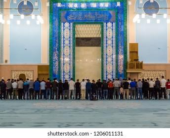 ASTANA, KAZAKHSTAN - JUNE 22, 2018: People praying in the Nur-Astana Mosque.