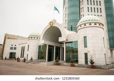 ASTANA, KAZAKHSTAN. October 12, 2018. Flag of Kazakhstan and coat of arms over the main entrance to the Kazakhstan Senate building in downtown Astana. The Republic of Kazakhstan state parliament