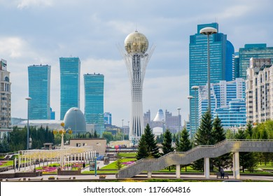 ASTANA, KAZAKHSTAN - Sep 2018: Bayterek is a monument and observation tower in Astana. And Different skyscrapers in the downtown. The height of Bayterek is 105 meters. Cloudy weather in the capital.