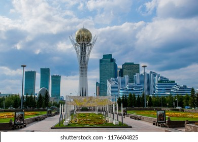 ASTANA / KAZAKHSTAN - Sep 2018: Bayterek is a monument and observation tower in Astana. And Different skyscrapers in the downtown. The height of Bayterek is 105 meters. Cloudy weather in the capital.