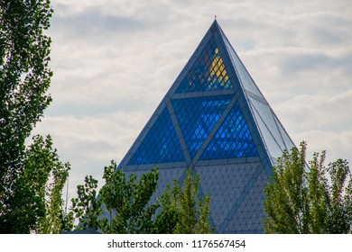 ASTANA, KAZAKHSTAN - Sep 2018: The Palace of Peace and Reconciliation, also translated as the Pyramid of Peace and Accord. The palace is located in the green Presidential Park.