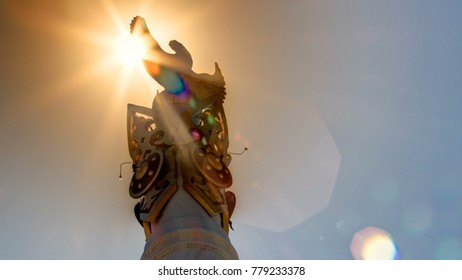 Astana, Kazakhstan. Sun passing over Stele monument Kazakh Eli with bird Samruk. Kazakhstan gained independence in 1991. The height of the monument 91 meters.