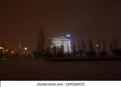 Astana (Nur-Sultan) / Kazakhstan – 11.09.2017: Modern buildings in Astana (Nur-Sultan), capital of Kazakhstan, on a winter night