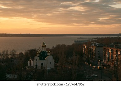 astern Orthodox Church on the river. Sky moving with god rays. Skylapse of the church with golden domes. Dome of the church reflecting floating sky