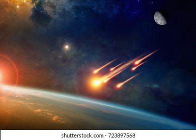 Asteroid impact, end of world, judgment day. Group of burning exploding asteroids from deep space approaches to planet Earth. Elements of this image furnished by NASA