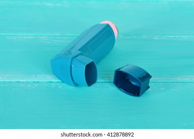 Asthma inhaler. Inhalation treatment of respiratory diseases. Allergy concept. Bronchial asthma medication
