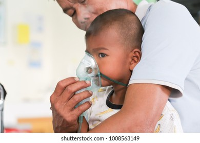 """""""Asthma patient"""",THAILAND, 12 DEC 2017 :Patient children boy diagnosis asthma  inhalation therapy the mask of inhaler.close up a little kid with respiratory disease problem or asthma.selective focus."""