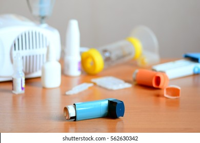 Asthma treatment medical equipment and medicines. Aerosol nebulizer, medical inhaler spray, peak flow meter, spacer, nebula, anti-inflammatory drugs to manage bronchial asthma. Bronchi asthma concept