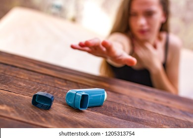 An asthmatic person is trying to reach the inhaler during an asthma attack. Asthma and COPD disease concept