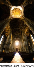 ASTI, ITALY - AUGUST 20, 2017: Cathedral of Asti, Italy. View of the main nave illuminated by the rose window at sunset, on august 20, 2017