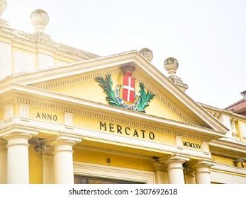 Asti, Italy - January 1, 2019. Main facade detail of The Mercato Coperto market. View from the Piazza della Liberta square. Asti, Piedmont, Italy.