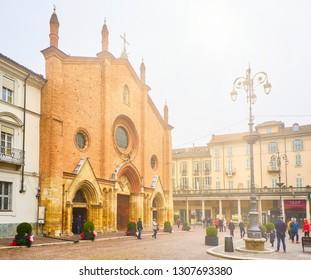 Asti, Italy - January 1, 2019. Main facade of The Saint Secondo Catholic Church, Collegiata di San Secondo. View from the Piazza San Secondo square. Asti, Piedmont, Italy.