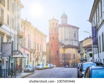 Asti, Italy - January 1, 2019. Corso Vittorio Alfieri street with Torre Rossa and The Chiesa di Santa Caterina Church in the background. View from the Piazza Fratelli Cairoli square. Asti, Piedmont.