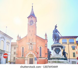 Asti, Italy - January 1, 2019. Sanctuary of San Giuseppe with The Monument to Umberto I in the foreground. View from the Piazza Fratelli Cairoli square. Asti, Piedmont, Italy.