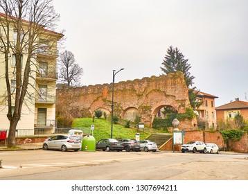 Asti, Italy - January 1, 2019. Asti City Walls. View from Piazza Paolo Lugano square. Asti, Piedmont, Italy.