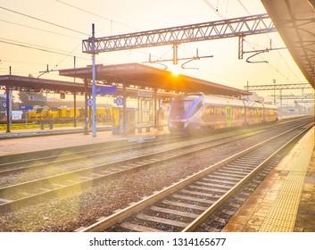 Asti, Italy - January 1, 2019. A train of Trenitalia in an Italian train station at sunset. Asti, Piedmont, Italy.