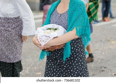 Asti, Italy - September 10, 2017: woman dressed in vintage clothes carries eggs in a basket