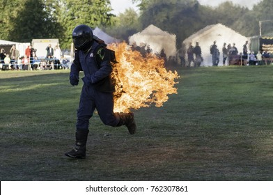 Astle Park, Cheshire, UK - August 12 2017: A stuntman on fire at Astle Park Traction Engine Rally