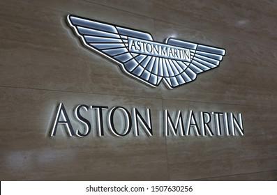 Aston Martin logo wall with backlights in Geneva International Motor Show (GIMS), Geneva Switzerland March 2019. Logo of the luxurious British car manufacturer. Color image.