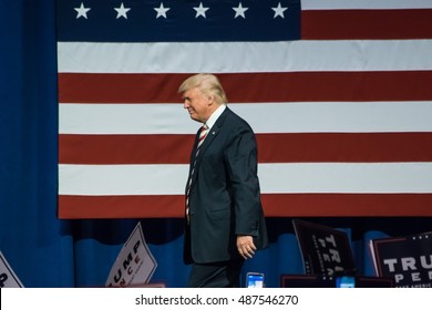 ASTON, PA - SEPTEMBER 22, 2016: Donald Trump walks by the American Flag on his way to deliver a speech at a campaign rally at Sun Center Studios.