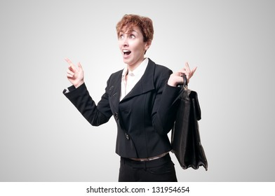 astonished business woman with briefcase on gray background