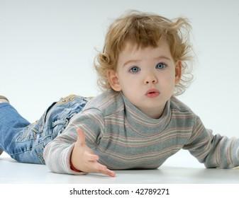 astonished child lying on the floor