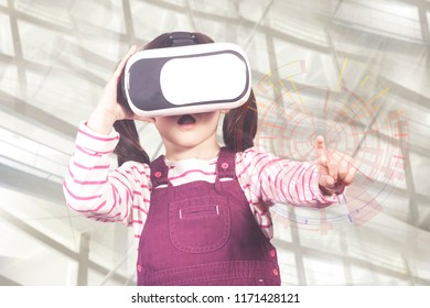 Astonished little girl experiencing virtual reality. (Image with mixed digital effects)