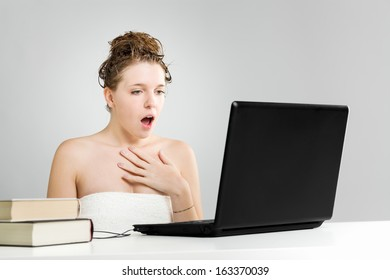 Astonished young girl in front of laptop
